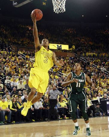 Trey Burke scores in the first half against Michigan State. Burke had the game-winning steal against Michigan State's Keith Appling