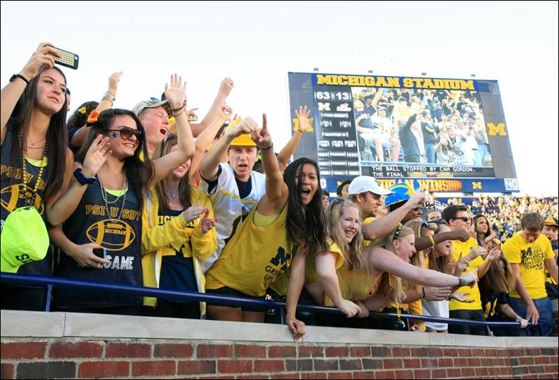 Of these students sitting up front at the Big House, chances are most of them are from Michigan (Photo courtesy of the Toledo Blade)